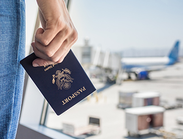 person holding passport at airport us consumer travel report